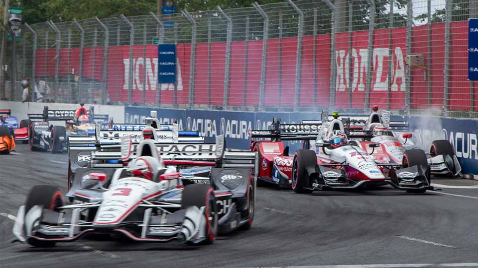 IndyCars speeding through the Honda Indy Toronto track